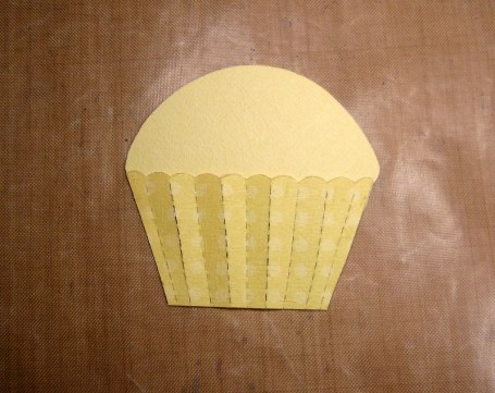 "I cut 1/4"" off the bottom of the cupcake and changed the shape of the top."
