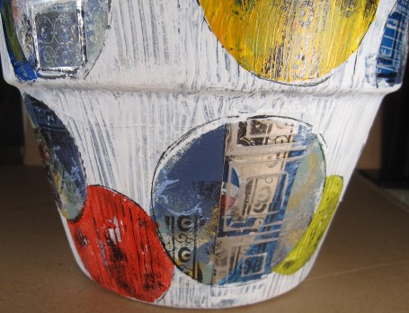 1st close-up of Pepsi cans collaged to sides of pot.