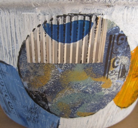 2nd close-up of Pepsi can collaged to sides of pot.